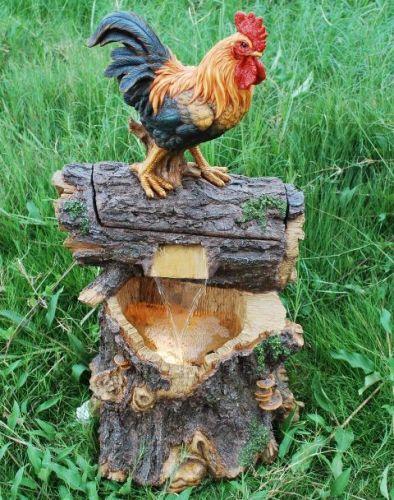Fontana con gallo sopra un ceppo di legno in poliresina for Fontane in legno